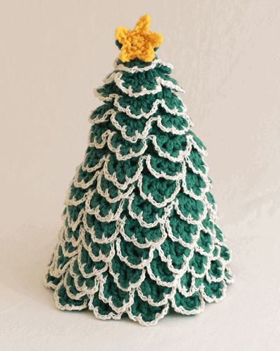 Crochet the Christmas Tree Toilet Paper Topper Pattern and add a little holiday spirit to your bathroom.