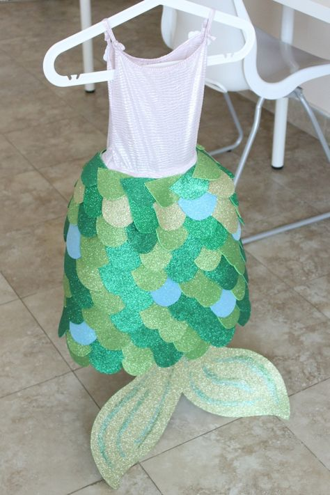 Front view of the totally adorable DIY mermaid costume, with glitter foam glued onto a sparkly dress.