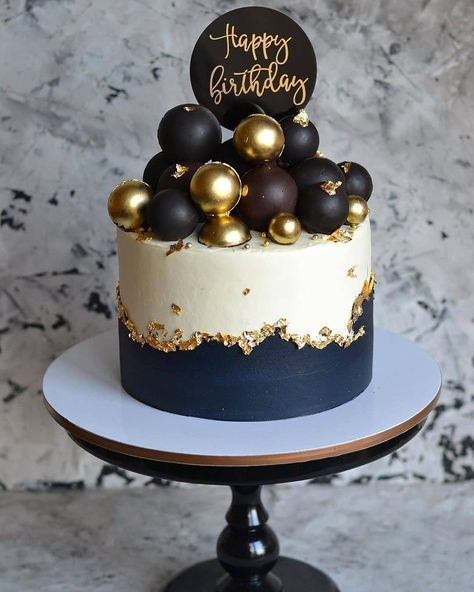 Super classy gold black and white on this cake by complete with gold mirror cake topper that we made ✨