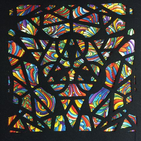 "Stained glass quilt by Cheryl Sleboda, made with a kaleidoscope stencil by Cecilia Swatton: ""I used the stencil on some fabric with fusible on it.  I worked from the paper side and then cut away all the ""windows"".  That left me with a piece of fabric that I can fuse down to any other fabric and get the ""peek-a-boo"" effect I want!"""