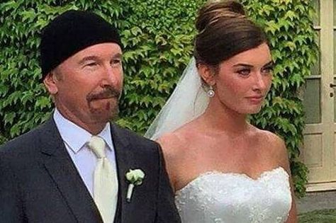 The Edge has taken his biggest stage yet - walking his daughter Hollie up the aisle.