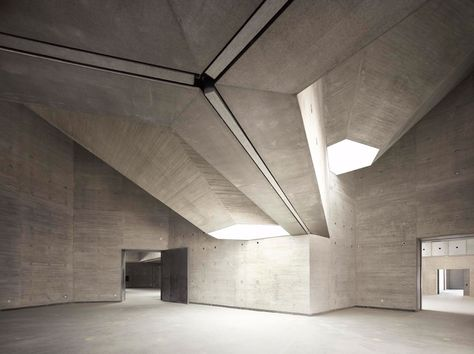 contemporary art center by nieto sobejano - interior gallery space illuminated from the skylights above