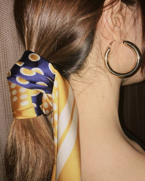 Jumping on the hairscarf pony trend. The polka dot bandana scarf in navy and gold is so versatile and can be worn so many ways. Pair it with a huge chunky gold hoop earring for extra vintage or retro vibes. Polka Dot Scarf and Haru Tube Hoops from www.thehexad.com