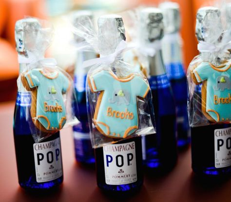 From mini pies to pint-sized bottles of bubbly, click through for baby shower favor ideas that'll blow their minds.