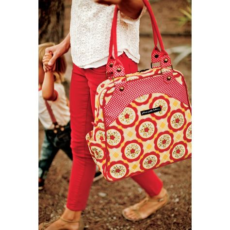 With playful pops of color and versatile carrying styles, the new Organic Cotton Marigold Medallions Sashay Satchel is one of this season's most delightful bags.