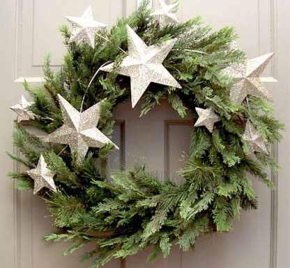 create a simple wreath with greens and glittered stars