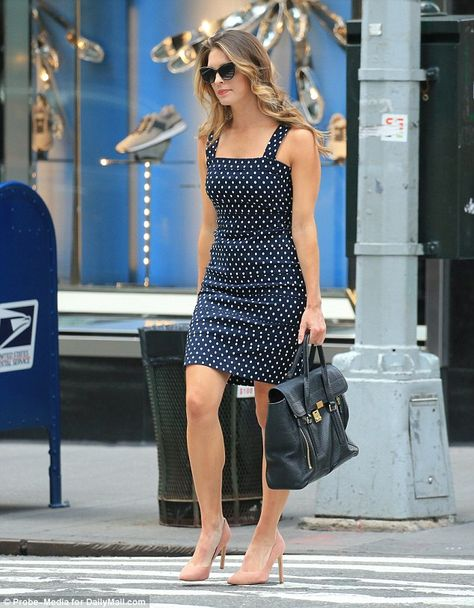 Hope looked ready for business in a pretty polka dot summer dress that she matched with nude stiletto heels