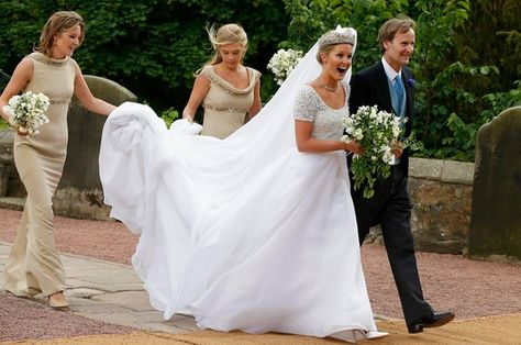 Lady Melissa Percy looks absolutely delighted as she is escorted by her father Ralph Percy, the Duke of Northumberland and two bridesmaids - including Prince Harry's ex Chelsy Davy (right) - as she makes her way into St Mary's Church in Alnwick