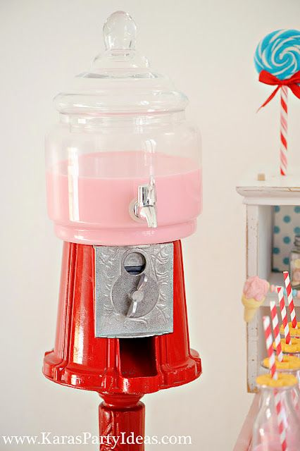 kara turned a gumball machine into a beverage dispenser! adorable sweet shoppe candy birthday party styled by www.karaspartyideas.com for zurchers. would make a lovely wedding dessert bar!