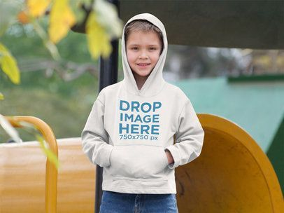 Download Placeit Hoodie Mockup Of A Young Boy At A Playground Youth Hoodies Oval Logo Kids Hoodie
