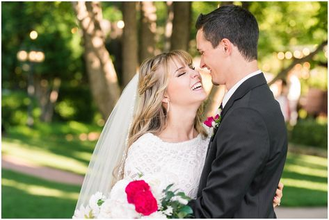 Bride and groom portraits candid moments laughing   white and deep pink florals with black suit and lace dress   Wadley Farms Summer Wedding   Jessie and Dallin Photography #wadleyfarms #utahwedding #utahsummerwedding #utahbride #utahweddings #utahvalleybride #summerwedding
