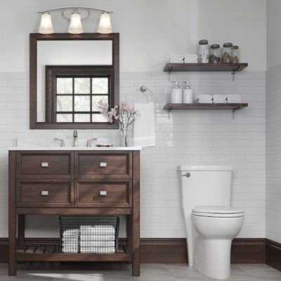 36 Inch Brown Canterbury Vanity Beside A White Toilet In A Light Colored Bathroom Cheap Bathroom Remodel Bathrooms Remodel Rustic Bathroom Vanities