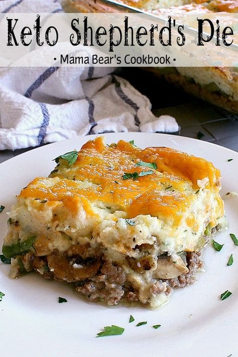 Better than the traditional, this Keto Shepherd's Pie is comfort food at it's best! It's loaded with beef, veggies, cauliflower mash and topped with cheese! #lowcarb #keto #comfortfood #mamabearscookbook