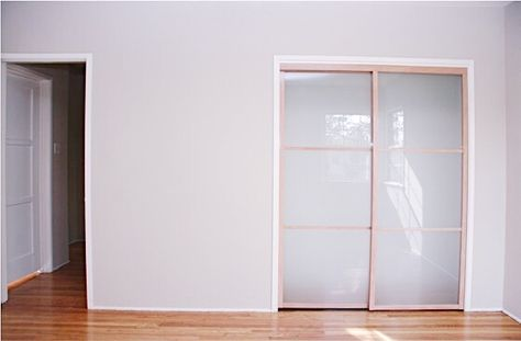 Check out this 2-track, 2-panel, top-hung closet door system with Maple Line Frames with white laminated glass doors that we installed! Get your closet doors up to date and cohesive with your home's interior theme! Visit www.chiproducts.com or call (866) 567-0400 today for an estimate. Common installation cities include Bellflower, California.