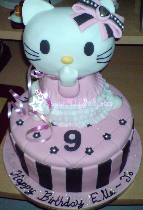 Large hand sculpted hello kitty cake ♡