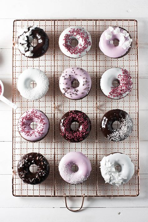 Chocolate cake doughnuts rich in flavor and full of fun! Dipped in all-natural pink glaze, topped with all-natural sprinkles, coconut flakes & cacao nibs. via @whiskwander