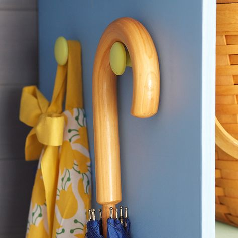 Hang oversize items, by mounting cabinet knobs on the side of a cubby. These hangers were made from painted wooden knobs.