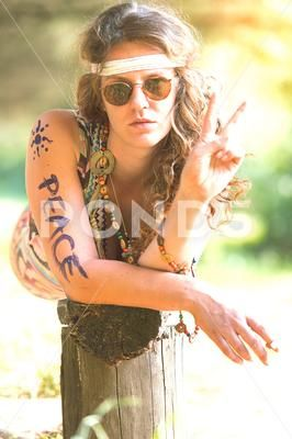Pretty free hippie girl. Peace. Body painting - Vintage photo effect ~ Premium Photo #84297994