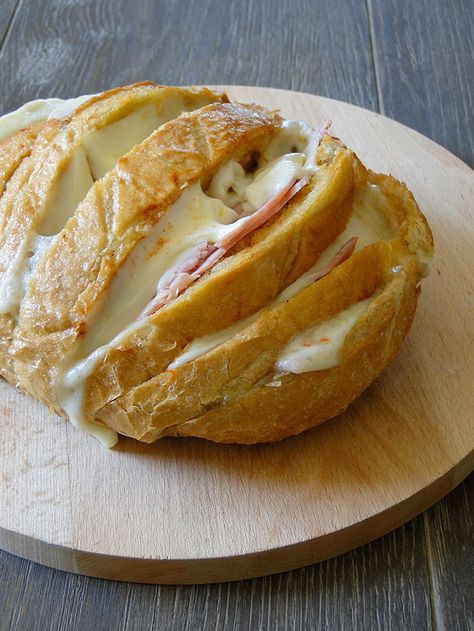 Stuffed bread loaf: Yum! Meats and cheeses melted into a bread loaf spread with seasoned garlic oil