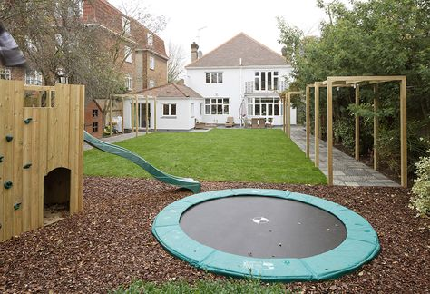 """kid friendly yard space..smart to bury the trampoline in a hole so the kids can't """"fall off"""" it..."""