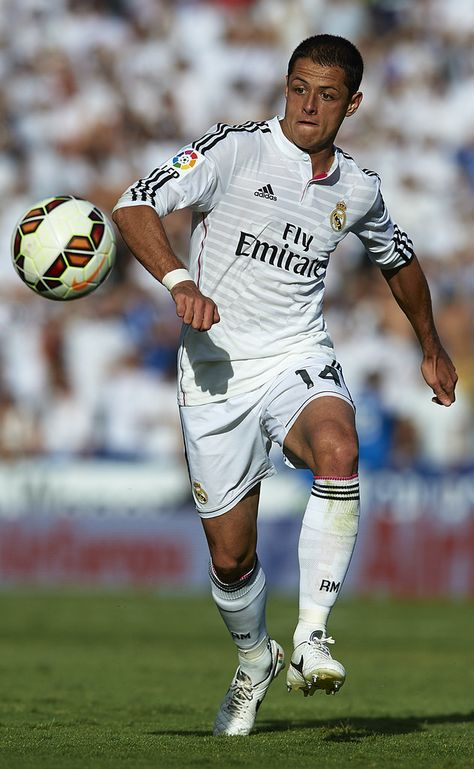 Javier 'Chicharito' Hernandez of Real Madrid runs with the ball during the La Liga match between Levante UD and Real Madrid at Ciutat de Valencia on October 18, 2014 in Valencia, Spain.