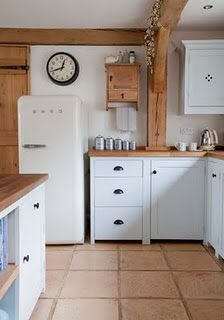 White and wood. Fab smeg fridge although maybe a splash of colour needed....a red smeg would be cool