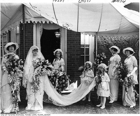 A beautifully dressed bride with her bridesmaids and flower girls,