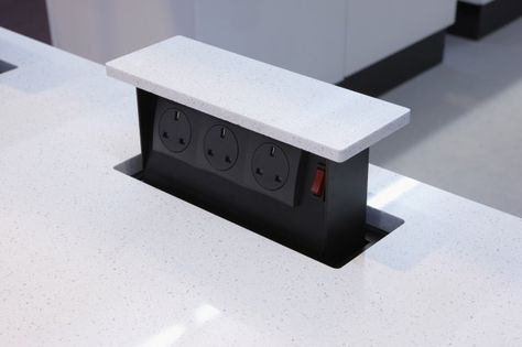 """Hidden electrical outlets that """"pop"""" up out of your countertops. They have pop up knives too"""