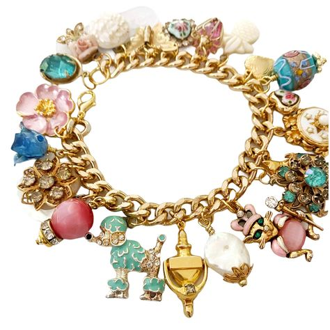 Excited to share this item from my #etsy shop: Handmade charm bracelet made from vintage jewelry. Gold tone chain with pink and blue, mother of pearl, rhinestone charms. Gift for women. #charmbracelet #vintagejewelry #handmadejewelry #goldbracelet #anniversarypresent #christmaspresent #giftforwomen #uniqueunusual #giftforwife #giftformom #giftforfriend