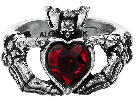 - Made of pewter - Height 1.8 cm - Width: 2.6 cm  This Claddagh by Night ring from Alchemy Gothic is decorated with a heart-shaped red ornamental stone. But the jewellers at Alchemy Gothic have not just created a ring with the symbol of passion and love. The metal-framed heart of the Claddagh by Night Rings is held by skeletal hands. The heart is crowned by a small skull.