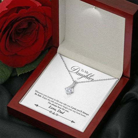 """Melt her heart with this ALLURING BEAUTY necklace gift! The petite ribbon shaped pendant is finished with 14K white gold over stainless steel, and is embellished with dainty clear crystals surrounded by a sparkling 7mm round cut Cubic Zirconia. The adjustable cable chain allows the necklace to be worn at 18"""" to 22"""" in length. This necklace is one of our best sellers! Be sure to get yours NOW!Product Dimensions: • Height: 0.8"""" (20mm) x Width: 0.4"""" (10mm)• 7mm cubic zirconia • 18""""-22"""" adjustable c"""