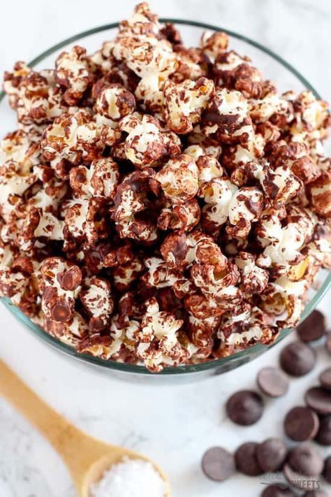A healthy sweet and salty snack of popcorn drizzled with melted dark chocolate and sprinkled with sea salt. Part dessert, part snack – completely delicious!