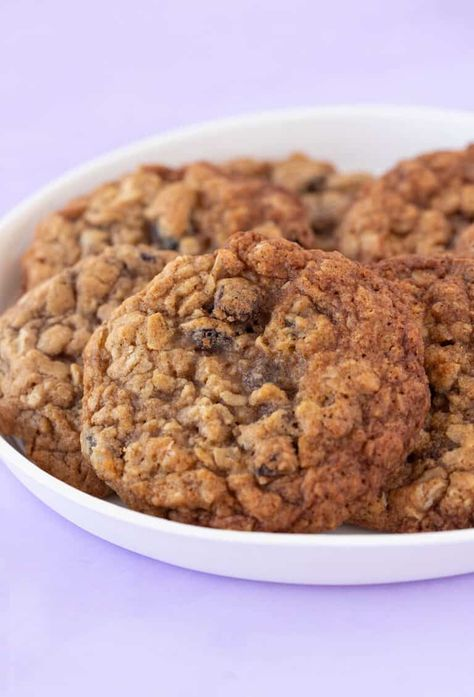 Learn how to make thin and chewy Oatmeal Raisin Cookies from scratch. These deliciously golden cookies have sticky edges and a chewy oaty cinnamon centre. There's no chilling the dough, so they're ready in minutes! Recipe from sweetestmenu.com #cookies #oatmealcookies #baking #dessert