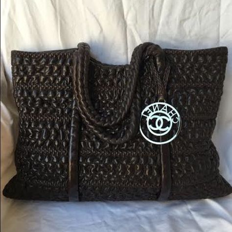 ac4fd77cdad8 Price reduced Price reduced - 100% Authentic Chanel dark brown quilted  lambskin XL tote. Interior zip pocket, two open pockets. Serial number  12560619.