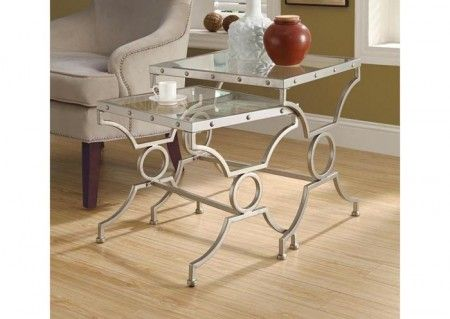 This edgy yet glamorous side table is super chic.   http://www.shoplet.com/Monarch-Furniture-SATIN-SILVER-2PCS-NESTING-TABLE-SET-WITH-TEMPERED-GLASS/MONI3321/spdv