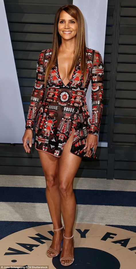HALLE BERRY ❤⭐ Sheer delight: Halle Berry put on a show-stopping display as she arrived at the Vanity Fair Oscars Party at the Wallis Annenberg Center for the Performing Arts on Sunday night after the Annua l Academy Awards in LA