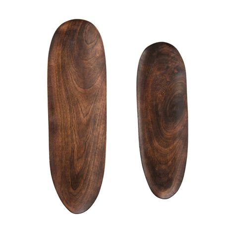 """These wood trays are a classic addition to any home. Made out of mango wood and featuring a dark finish, this pieces blends seamlessly with any kitchen décor. Perfect for serving friends and family, in entryways, or setting atop coffee tables.These mango wood trays are perfect for serving friends and family in style, or placing on coffee tables as a decorative accentMade out of mango woodComes in a set of 2Can be used in entryways, kitchens, and coffee tables19-1/2""""L x 6""""W"""