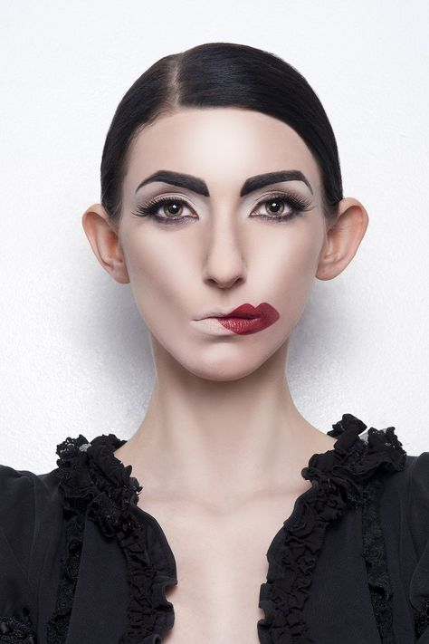 Avant garde makeup. This would be so awesome for a photoshoot