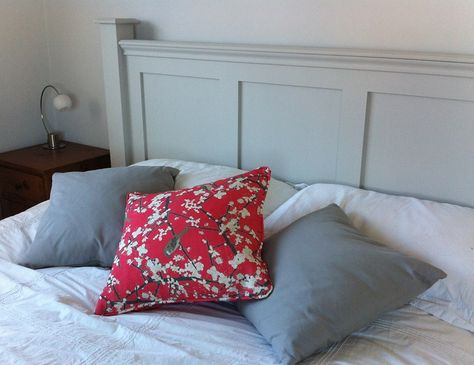 Cushions in a plain linen from Clarke and Clarke, and Emily Burningham Hawthorn and Sparrow fabric