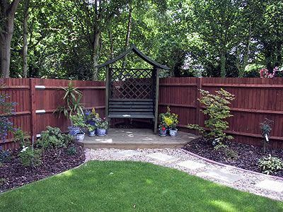 Small Deck In Corner Of Fences Landscapes Koi Pond And Water Feature Specialists Hampshire Corner Landscaping Fence Landscaping Backyard Fences
