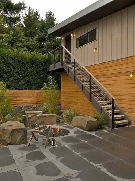 Moderne Gartengestaltung Steinen Sitzbaenge Idee Feuerstelle Deko