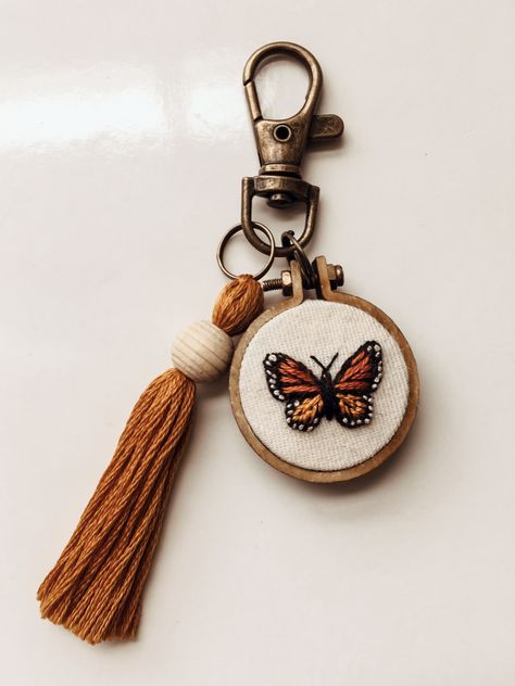 embroidery Monarch Butterfly Keychain K E Y C H A I N 4 inches long small wood hoop is 1 inch antique bronze lobster clasp stitched with cotton thread creamy white cott Butterfly Embroidery, Hand Embroidery Stitches, Modern Embroidery, Embroidery Hoop Art, Hand Embroidery Designs, Cross Stitch Embroidery, Embroidery Ideas, Knitting Stitches, Hand Stitching