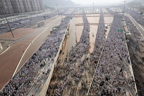"Thousands of Muslim pilgrims arrive to throw pebbles at pillars during the ""Jamarat"" ritual, the stoning of Satan, in Mina near the holy city of Mecca."
