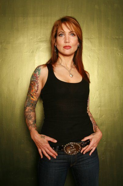 Hannah Aitchison (born December 20, 1966) is an American tattoo artist from Chicago, Illinois.Aitchison is the sister of tattoo artist, Guy Aitchison.Focuses her art on bold and colorful works of life-like portraits, pin-ups and classic Americana.