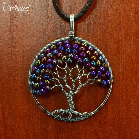 This wire tree of life necklace pendant was constructed with .925 sterling silver wire. The tree of life contains color shifting glass beads that give appearance of autumn foliage to the tree. The glass beads display colors or red, purple, yellow, and pink. To accentuate the wrapped wire, I applied a - Online Store Powered by Storenvy