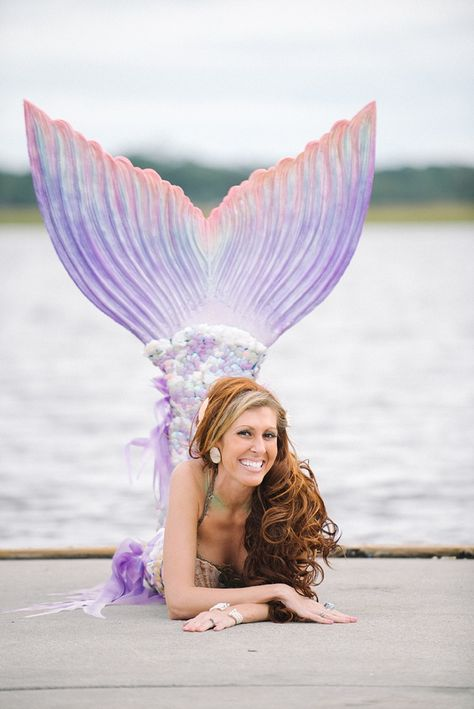 """Mermaid Coral Beth, a member of Kariel's Mermaids on a Mission, wearing her """"Tail of Art"""" tail by Mermaid Kariel. This tail is a hybrid tail meaning the fins are made of silicone and the body is sequins."""