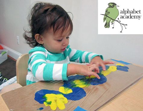 No mess sensory art! Put 2 colors of paint onto cardboard and cover with saran wrap. Smush and pat all you want with no mess and a cool textured look! - Alphabet Academy South Toddlers  http://thealphabetacademy.com