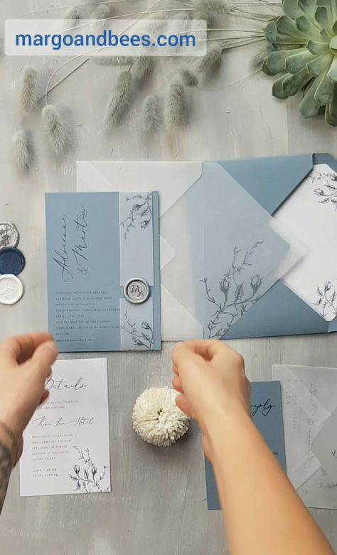 Dusty blue wedding invitations with transparent envelopes