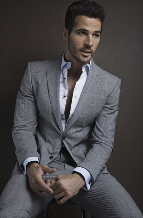 Grey suit white shirt, no tie, keep it simple and fresh.