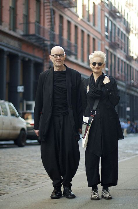 Professor Ben Fletcher and Professor Karen Pine from London on Mercer St. The tiny buttons on the cuff, the oversized bag and the funky shoes give a particular feel to this all black outfit. With different accessories the look can easily be changed.
